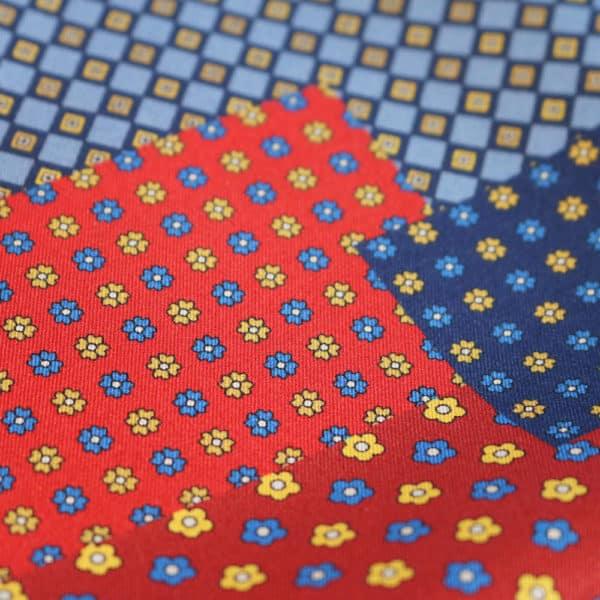 Amanda Christensen pocket square black red blue geometric flower fabric