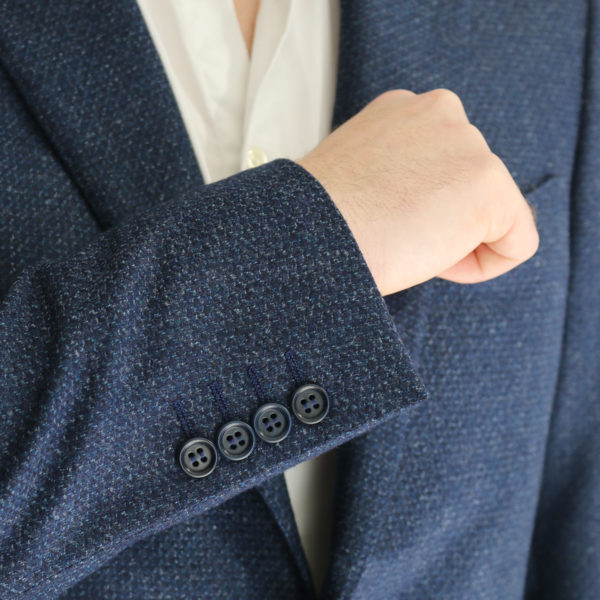 Canali navy waffle textured jacket button detail