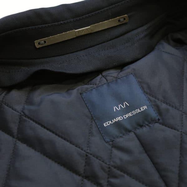 Eduard Dressler black raincoat logo