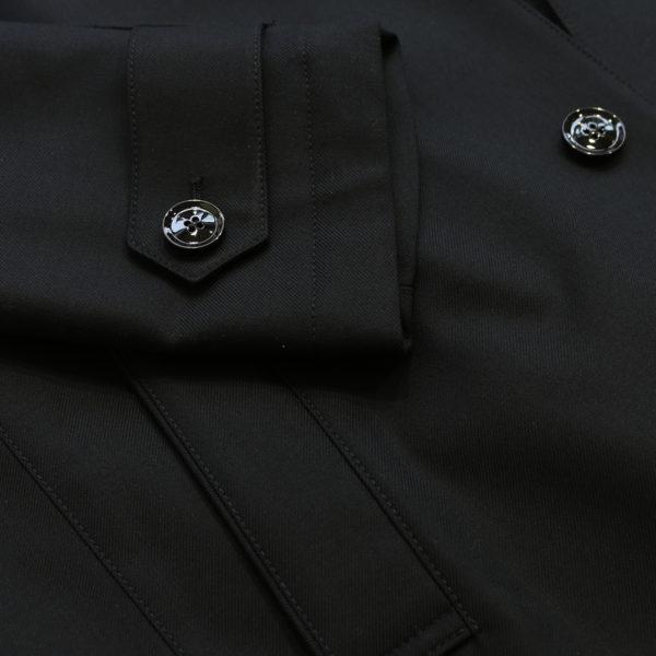 Eduard Dressler black raincoat sleeve detail