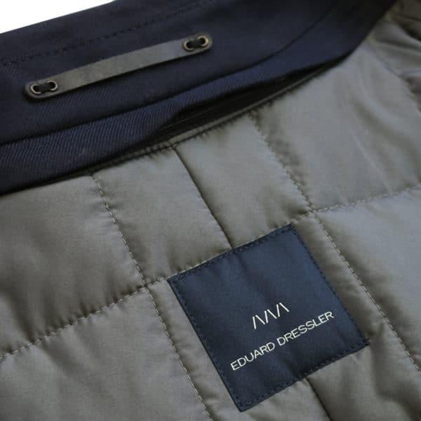 Eduard Dressler navy raincoat logo detail