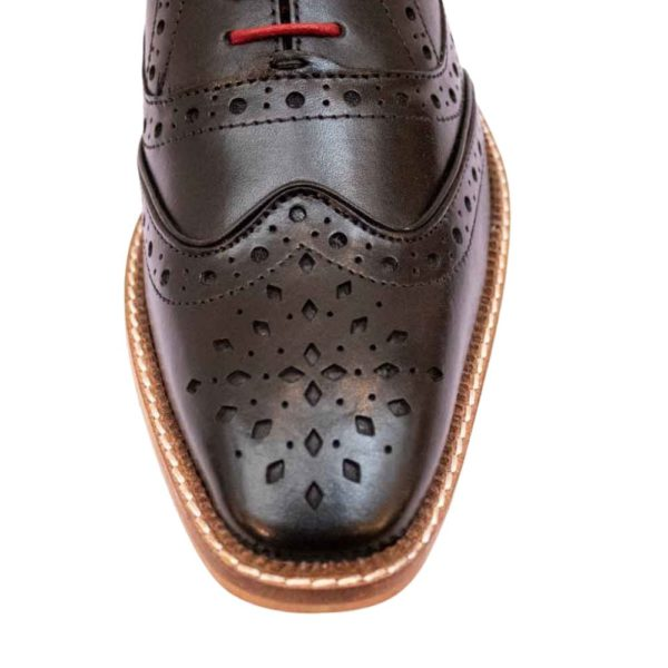 marc darcy black shoe close up