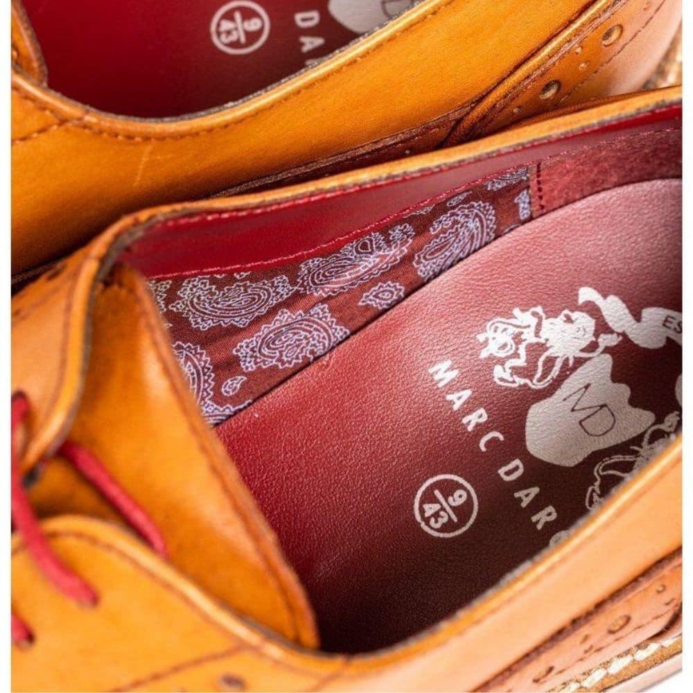 marc darcy tan shoe close up