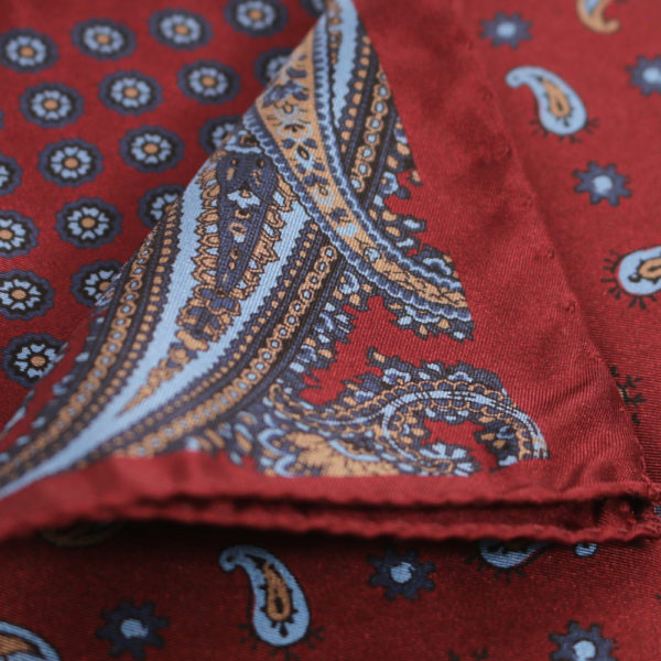 Amanda Christensen pocket square burgundy quarter close up