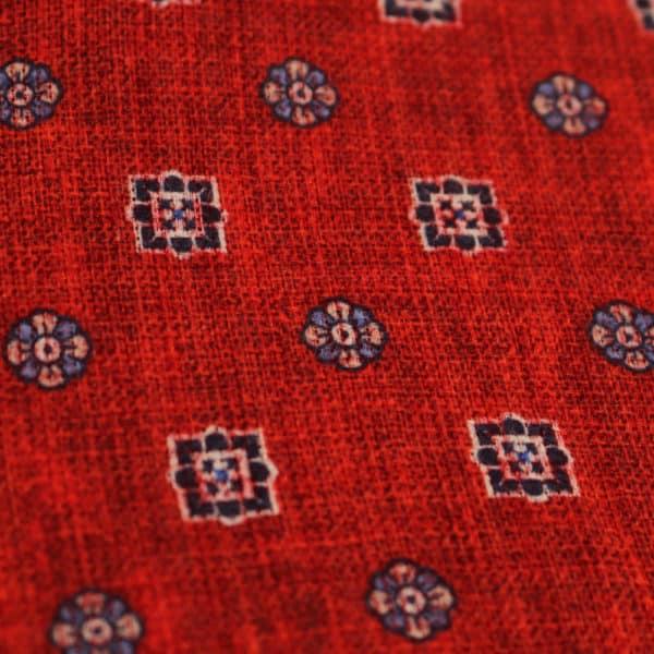 Amanda Christensen pocket square red buttons closeup