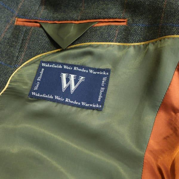 Warwicks jacket khaki with orange stripe lining detail